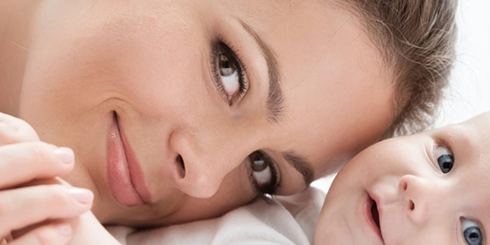 happy mother and baby image